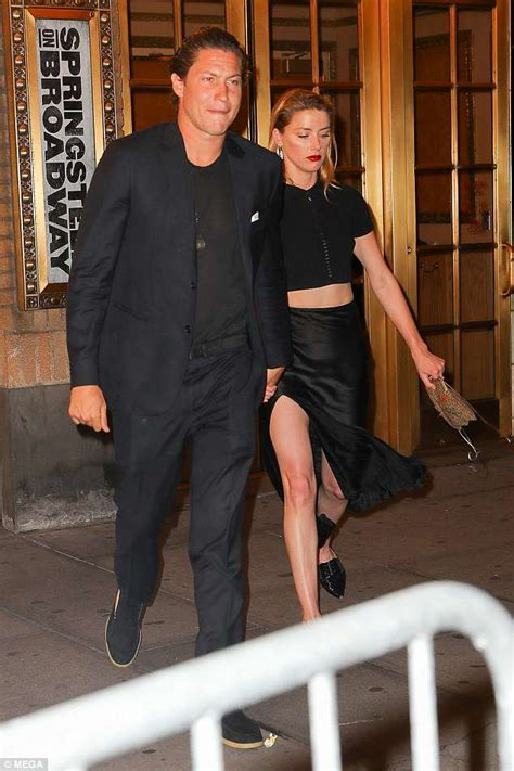 Amber Heard and Vito Schnabel wear black ensembles on date