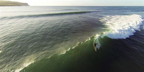 Surfers in Ireland Ride Cold Waves in Lahinch, Ireland